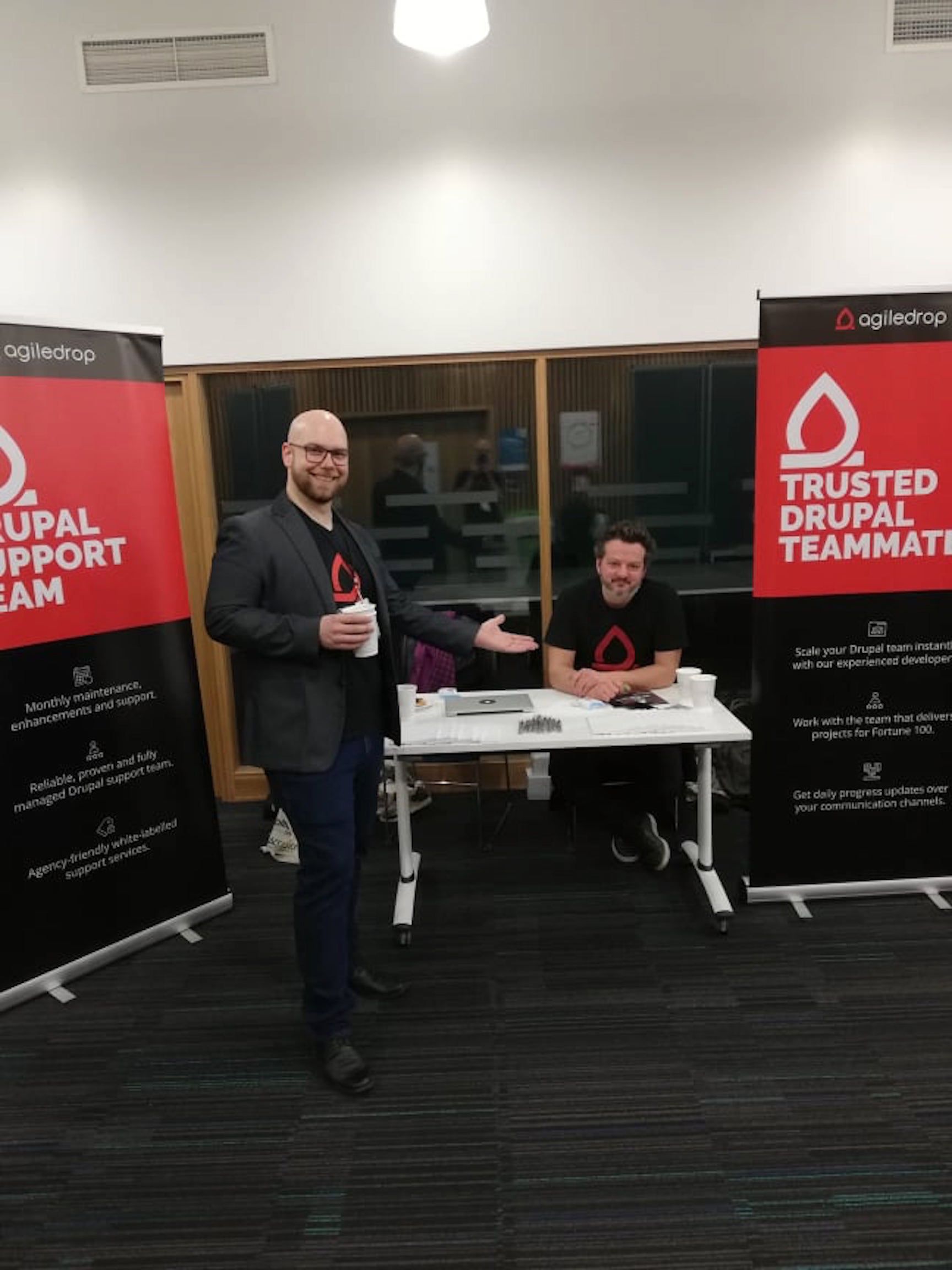 Aleš and Iztok at Agiledrop's booth at DrupalCamp London 2019