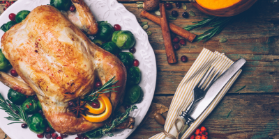 Thanksgiving dinner table with turkey and cutlery