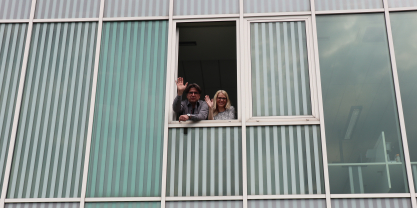 Domen & Maja waving from the new office