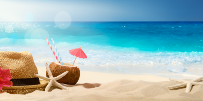 The beach with straw hat, coconut drink with straw and paper umbrella, and starfish