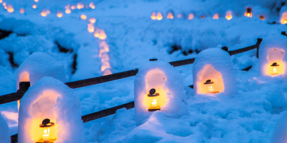 Row of candles inside snow sculptures