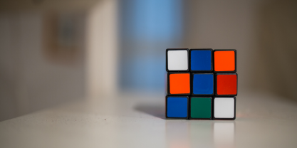 Unsolved Rubik's cube on white desk