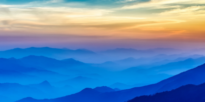 Mountainous landscape during sunsets with differently colored layers