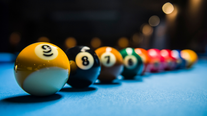 Pool balls lined in a row with 9 as the first one