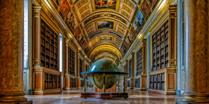 Colorful library with big globe in the center of the room