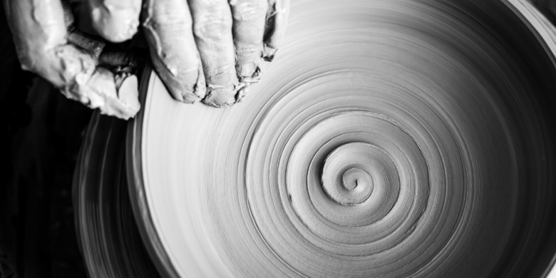 Skilled hands doing pottery spiral