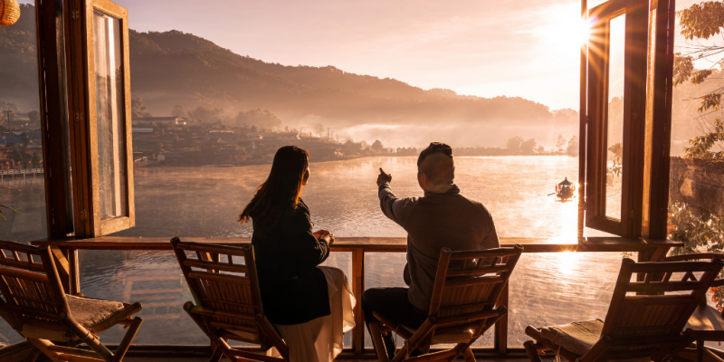 Couple having a view of bay during sunset