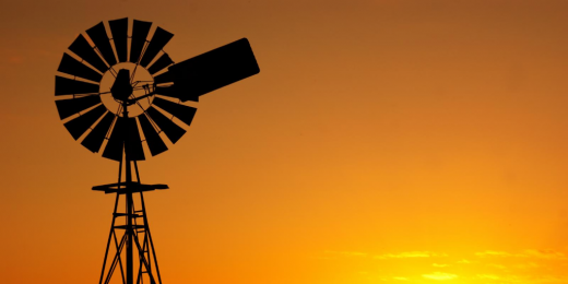 Outline of windmill in the sunset